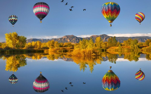 flying_air_ballons_reflections-wide